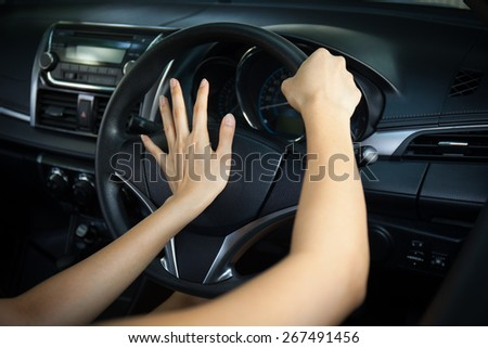 Cockpit drive abstract. hand pushing horn - stock photo