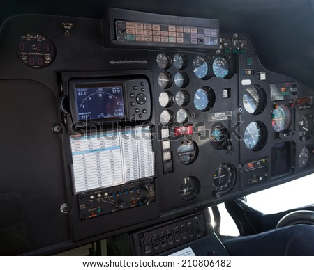 cockpit in interior of helicopter cabin - stock photo