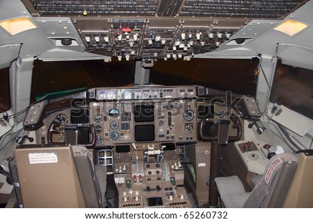 cockpit of a commercial passenger airliner without pilots - stock photo