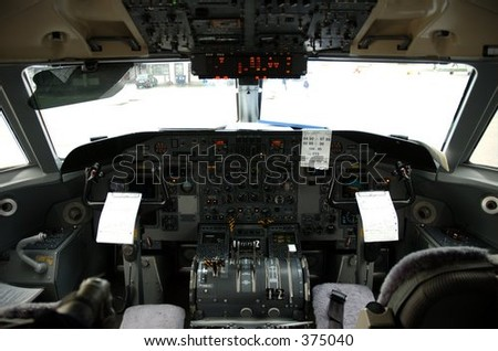 Cockpit of a Dash 8 103 - stock photo