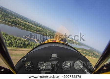 Cockpit view from small vintage aircraft - stock photo