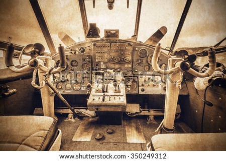 Cockpit view of the old retro plane. - stock photo