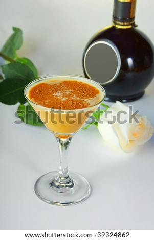 Cocktail alcoholic with a bottle and Rose - stock photo