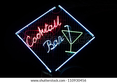 Cocktail bar neon sign illuminated at night - stock photo