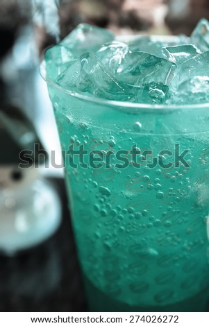Cocktail blue hawaiian with alcohol, vodka, crushed ice - stock photo