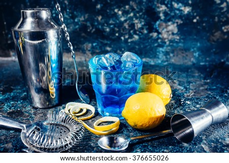 cocktail drink as refreshment on bar counter, served cold. Long, alcoholic drink with lemon garnish - stock photo