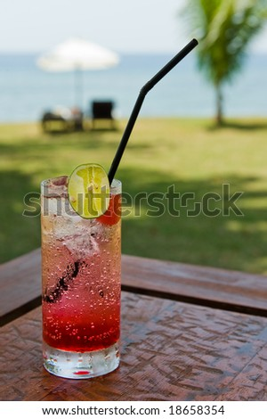 cocktail drink on the beach - stock photo