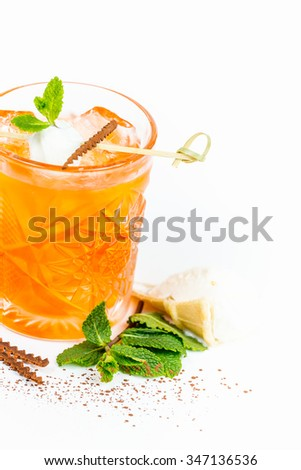 Cocktail drink with cinnamon ice cream and mint. White background. cinnamon Powder