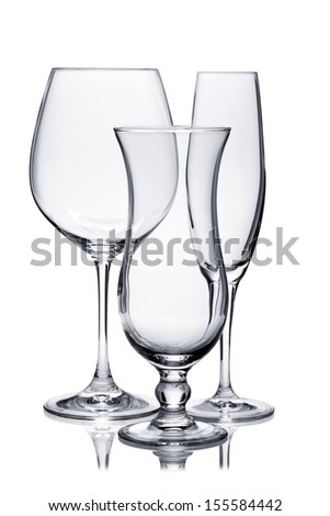 Cocktail glass set. Empty glasses of champagne, red wine and hurricane isolated on white background - stock photo