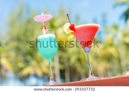 Cocktail glasses at pool, beach side.