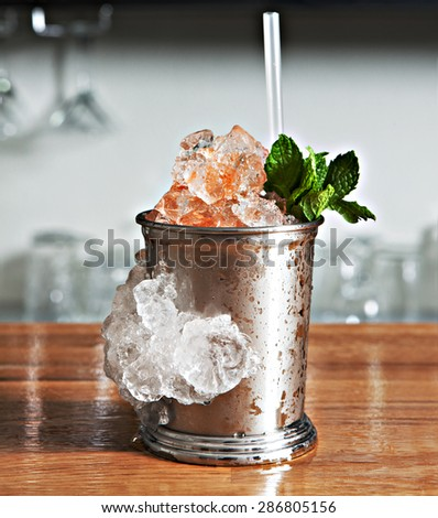 cocktail in a bar with ice in glass - stock photo