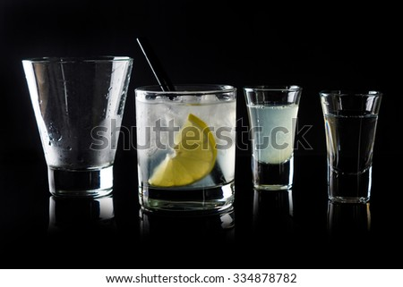 Cocktail making on the black background - stock photo