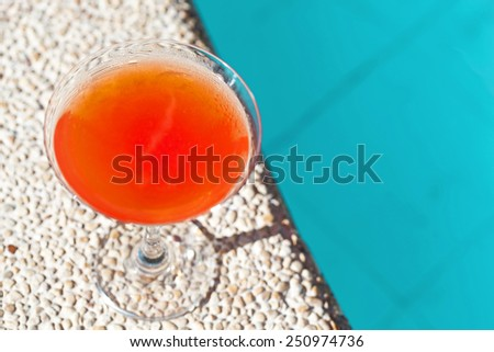 Cocktail Margarita with ice near swiming pool, nobody - stock photo