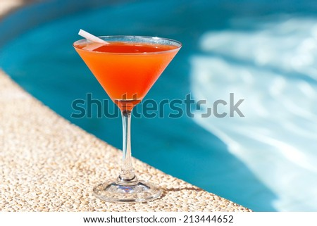 Cocktail Margarita with ice near swimming pool, nobody - stock photo