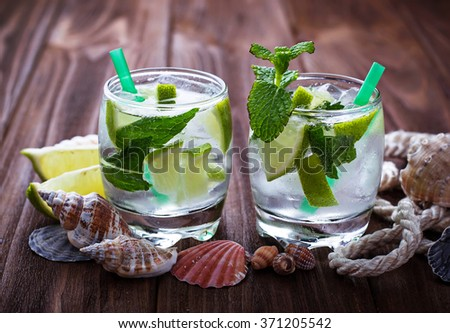 Cocktail mojito with rum, mint, ice, lime. Selective focus - stock photo