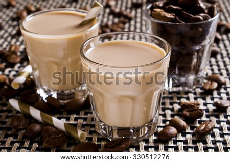 Cocktail of coffee and cream in a glass container. Selective focus - stock photo