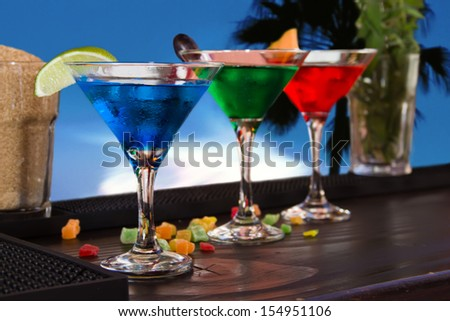 Cocktail on a bar with a decor - stock photo