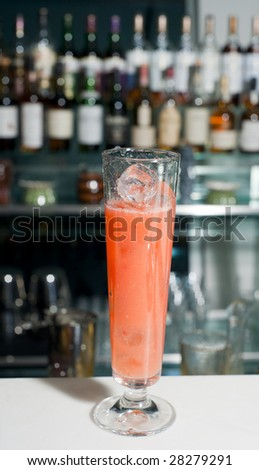 Cocktail on bar counter, focus on foreground - stock photo