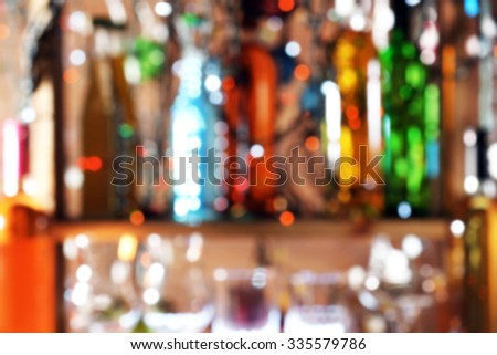 Cocktail on bar on defocused lights - stock photo