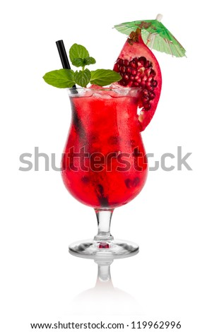 Cocktail pomegranate in front of white background - stock photo