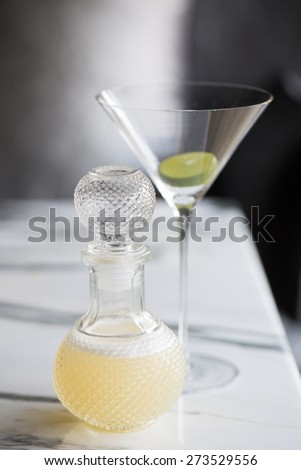 Cocktail serve in beautiful bottle on marble table - stock photo