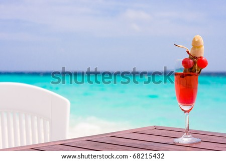 Cocktail sex on a table at the tropical beach - stock photo