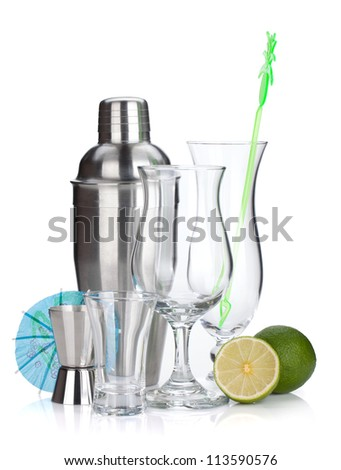 Cocktail shaker, glasses, utensils and lime. Isolated on white background - stock photo