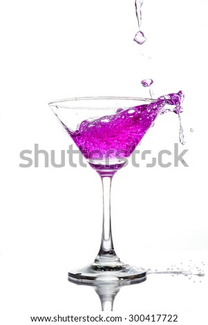cocktail splash on white background close up