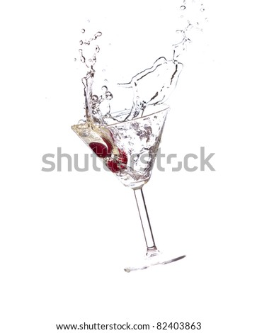 Cocktail splash, with red cherries splashing in to a cocktail glass