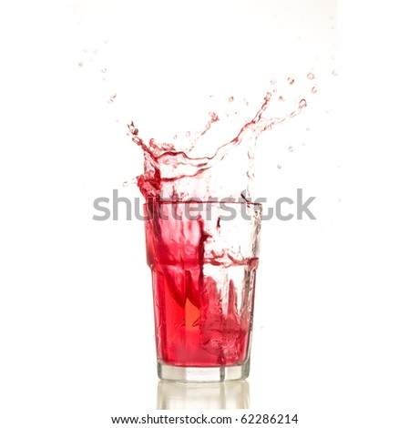 Cocktail splashing on a glass on white background