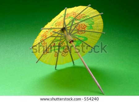 cocktail umbrella - yellow #2 - stock photo