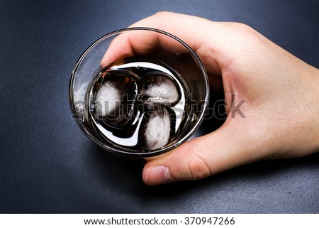 Cocktail whiskey-cola on a table in bar - stock photo