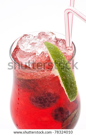 Cocktail with a raspberry and a blackberry with ice slices in a transparent glass close up - stock photo
