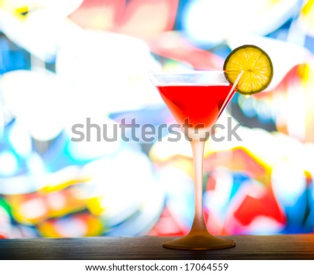 Cocktail with colurful background - stock photo