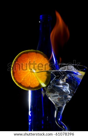 Cocktail with flame on the black background - stock photo