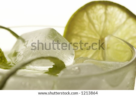 cocktail with ice and lemon with lime peel