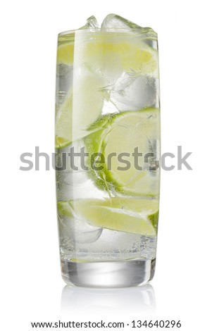 Cocktail with ice and lime slice isolated on white background - stock photo