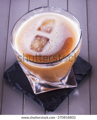 Cocktail with ice in a glass, seen from above, vertical image - stock photo