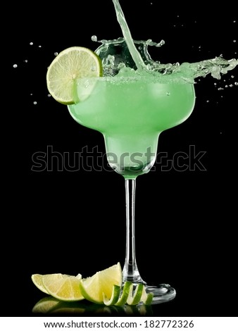 Cocktail with lime in margarita glass splash