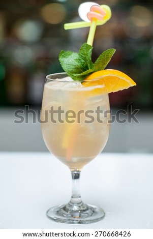 Cocktail with mint and orange in a glass - stock photo