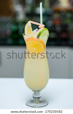 Cocktail with orange and lime in a glass - stock photo