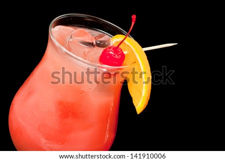 cocktail with red cherry and orange closeup - stock photo