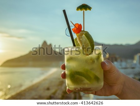 Cocktail with Rio de Janeiro, Brazil beach background - stock photo