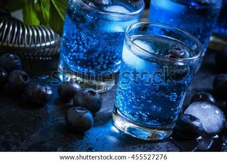 Cocktail with soda, gin and berries, black background, selective focus - stock photo