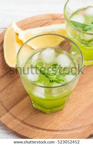 cocktail with tarragon on a wooden board
