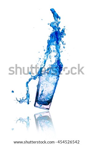 Cocktails blue splash out of glass on a white background. - stock photo