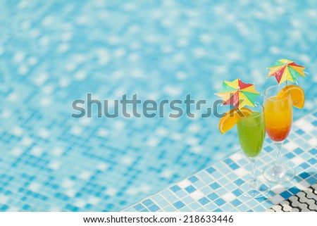 Cocktails by he pool - stock photo