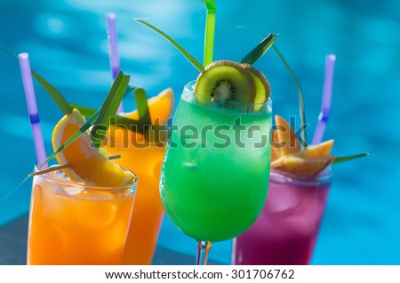 Cocktails by the pool - stock photo