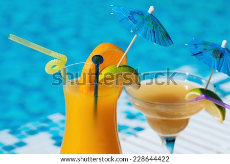 Cocktails near the swimming pool. Vogue style - stock photo