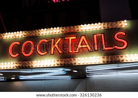 Cocktails Neon Sign and Lights. Cocktails sign in neon and surrounded by flashing lights. - stock photo